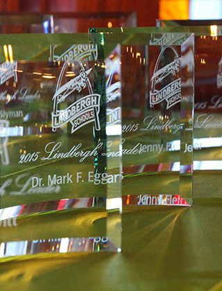 Close up of crystal awards displayed on a table