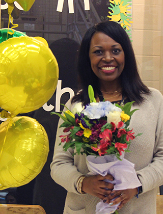 Dr. Ta'Keshia Parker poses for a photo after receiving the Exemplary New Principal award