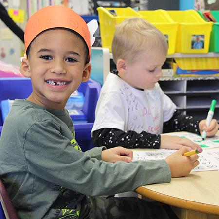 Kindergarten student sitting at desk