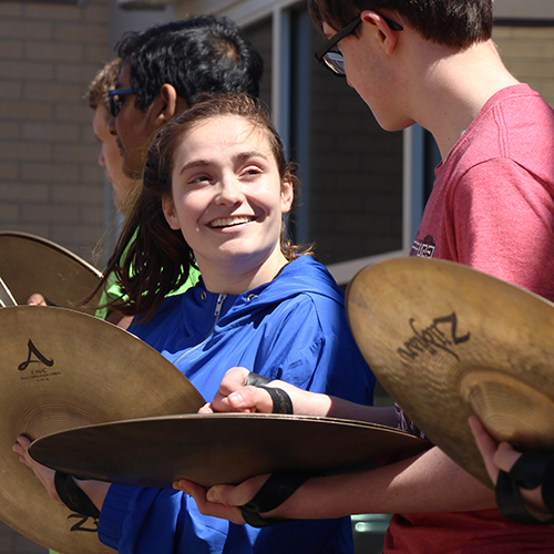 LHS drumline members holding cymbals