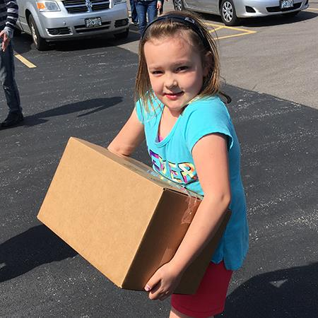 Girl Scouts Collect Items for Women in Need