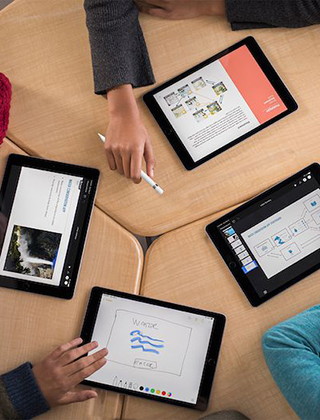 Students using iPads to work together on a school project