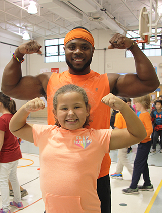 Darrion Cockrell posing with student