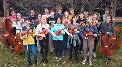 Lindbergh High School Orchestra students pose with their instruments
